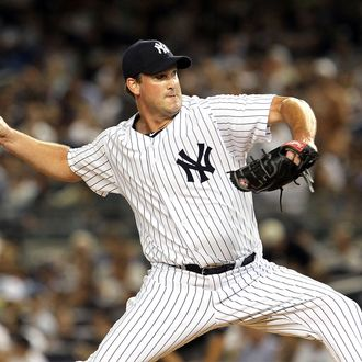 Derek Lowe #34 of the New York Yankees pitches against the Texas Rangers at Yankee Stadium on August 13, 2012 in the Bronx borough of New York City.