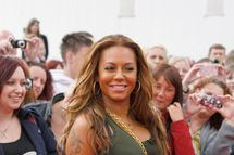 MANCHESTER, UNITED KINGDOM - JUNE 06: Melanie Brown arrives for the X Factor auditions on June 6, 2012 in Manchester, England. (Photo by Nathan Cox/Getty Images)