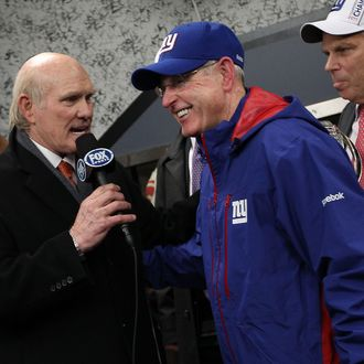 Head coach Tom Coughlin (R) of the New York Giants is interviewed by Terry Bradshaw after the Giants won 20-17 in overtime against the San Francisco 49ers during the NFC Championship Game at Candlestick Park on January 22, 2012 in San Francisco, California.