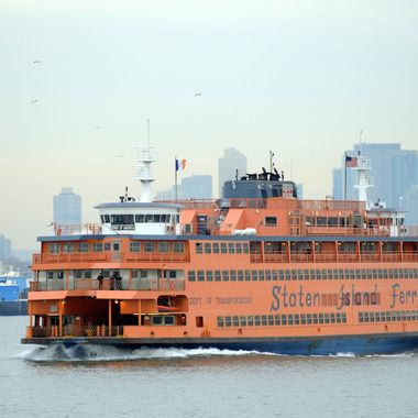 The Staten Island Ferry passes the Statue of Liberty as it makes it's ways south from Manhattan to Staten Island on January 15, 2010 in New York.