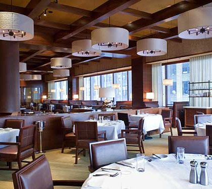 Restaurateurs have been trying to update the classic big-city steakhouse for decades now, but at this posh, unapologetically traditional beef house in the Time Warner Center, Michael Lomonaco sticks to the time-tested formulas. For maximum beefy pleasure, I suggest the tender, chile-rubbed rib eye, from the famous Brandt Ranch in California. Complement it, if you dare, with a rasher of the Bunyanesque hash browns and a vat or two of the opulent creamed spinach, which Lomonaco tops, almost criminally, with a crumbling of bacon.