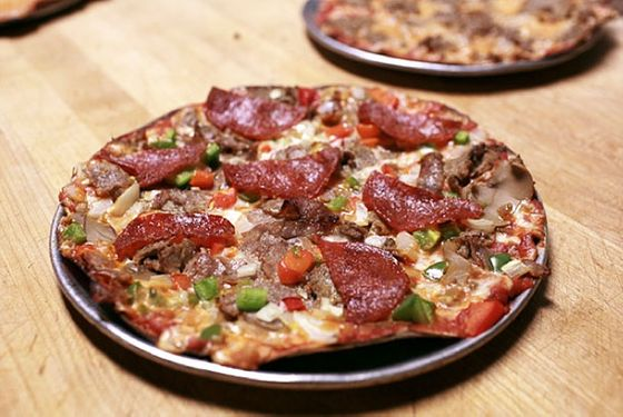 "<b>Bar Pie</b>    <a href=""http://www.eddiespizzany.com/restaurant/"">Eddie's Pizza</a>    <i>New Hyde Park, New York</i>  The Long Island bar-pie specialists have been turning out thin, crispy, small pizzas for 70-plus years, but that doesn't mean they're stuck in the past. In 2010, Eddie's <a href=""http://newyork.grubstreet.com/2010/05/eddies_pizza_of_long_island_tr.html"">launched</a> its own <a href=""https://twitter.com/EddiesPizzaNY"">Manhattan food truck</a> that turns out the shop's signature item. No beer, though — which means you might still want to make a trip out on the LIRR to check out the original."