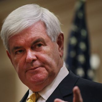 NAPLES, FL - NOVEMBER 25: Republican presidential hopeful and former Speaker of the House Newt Gingrich speaks to overflow crowds at a Hilton Hotel on November 25, 2011 in Naples, Florida. Gingrich discussed foreign policy issues and restated his position on illegal immigrants in the United States. Gingrich, who has rose in recent polls following strong debate performances, had been written off earlier this year and is now expected to do well in the Iowa caucuses in early January. (Photo by Spencer Platt/Getty Images)
