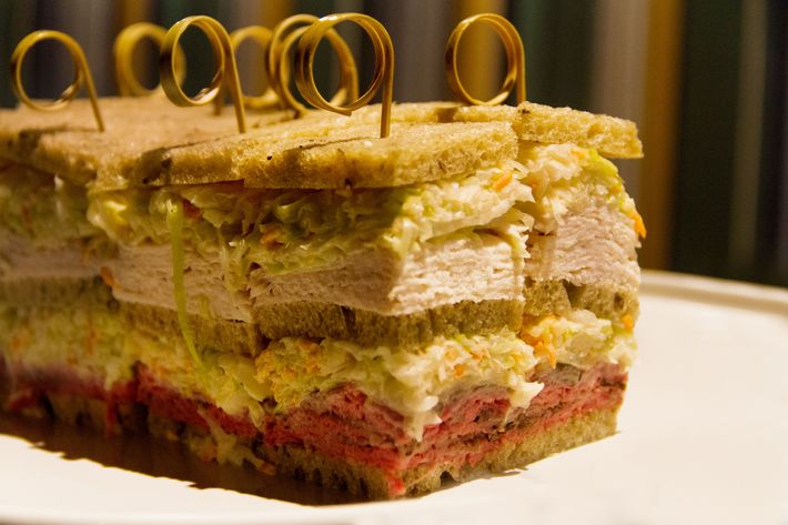 Triple-decker sandwich with turkey and roast beef.