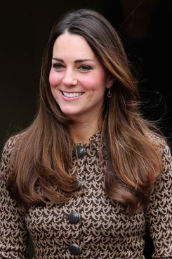 Catherine, Duchess of Cambridge smiles as she leaves the Only Connect and ex-offenders projects on November 19, 2013 in London, England.