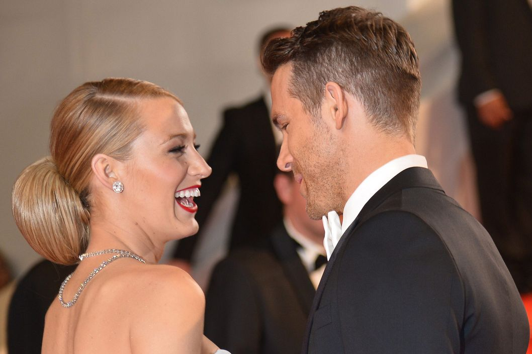 "Canadian actor Ryan Reynolds and his wife US actress Blake Lively pose as they arrive for the screening of the film ""Captives"" at the 67th edition of the Cannes Film Festival in Cannes, southern France, on May 16, 2014."