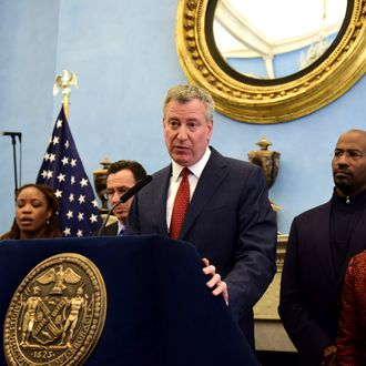 02 Apr 2015, Manhattan, New York City, New York State, USA --- New York, United States. 2nd April 2015 -- Surrounded by the city's first lady Chirlane McCray and progressive leaders at Gracie Mansion, mayor Bill de Blasio opens a press conference that followed a meeting over the issue of growing income inequality in the US. -- New York City mayor Bill de Blasio met with progressive leaders from around the country at Gracie Mansion for a conference to develop strategies in addressing the growing income disparity in the United States. A brief press conference followed. --- Image by ? Andy Katz/Demotix/Corbis