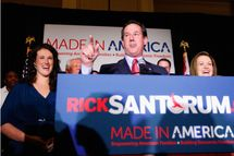 ST. CHARLES, MO - FEBRUARY 7:  Republican presidential candidate, former U.S. Sen. Rick Santorum speaks to supporters as his daughter, Elizabeth (L), and wife, Karen (R), look on February 7, 2012 at the St. Charles Convention Center in St. Charles, Missouri. According to early results, Santorum defeated former Massachusetts Gov. Mitt Romney, former Speaker of the House Newt Gingrich and U.S. Rep. Ron Paul (R-TX) in Missouri, Minnesota and is leading in Colorado.  (Photo by Whitney Curtis/Getty Images)