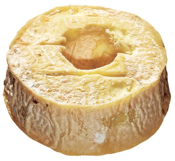 "<b>Torus</b>    <i>Vermont Creamery (Vermont)</i>    A special strain of mold called Geotrichum candidum gives this doughnut-shaped goat's-milk cheese its powdery appearance and sweet, minerally flavor. The shape, with its increased crust-to-paste ratio, is modeled after the French couronne, or crown, and it's a favorite among those who find particular pleasure in eating cheese rinds and the rich cream line that lies beneath them. The cheese, a collaboration between Murray's and Vermont Creamery, is aged in Murray's caves, 15 feet below Bleecker Street. <i>$11 each at <a href=""http://nymag.com/listings/stores/murrays-cheese01/"">Murray's Cheese</a>.</i>"