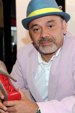 WEST HOLLYWOOD, CA - APRIL 28:  Designer Christian Louboutin poses for a photo at the grand opening of the new Christian Louboutin boutique on April 28, 2010 in West Hollywood, California.  (Photo by Alberto E. Rodriguez/Getty Images)