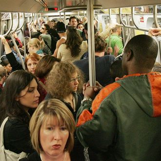 Subway passengers ride a crowded L train October 9, 2005 in New York City. New Yorkers continued to ride the subway today, the date officials warned of a possible terror attack on the subway. (Photo by Mario Tama/Getty Images)