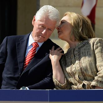 DALLAS, TX - APRIL 25: Former first lady and former Secretary of State Hillary Rodham Clinton speaks with her husband former president Bill Clinton as they attend the opening ceremony of the George W. Bush Presidential Center April 25, 2013 in Dallas, Texas. The Bush library, which is located on the campus of Southern Methodist University, with more than 70 million pages of paper records, 43,000 artifacts, 200 million emails and four million digital photographs, will be opened to the public on May 1, 2013. The library is the 13th presidential library in the National Archives and Records Administration system. (Photo by Kevork Djansezian/Getty Images)