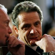 New York City Mayor Michael Bloomberg, left, and New York Gov. Andrew Cuomo during a ceremony in the Red Room at the Capitol in Albany, N.Y., on Friday, March 16, 2012.  (AP Photo/Mike Groll)