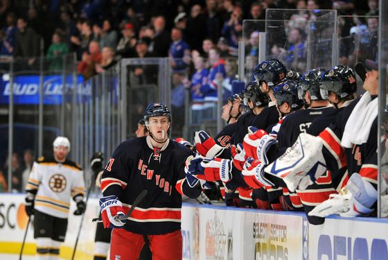 NEW YORK, NY - MARCH 04:  Derek Stepan #21 of the New York Rangers is congratulated after scoring the game winning goal during the third period against the Boston Bruins at Madison Square Garden on March 4, 2012 in New York City. (Photo by Christopher Pasatieri/Getty Images)