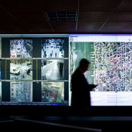 Monitors display live video feed from various locations around the city at the New York Police Department surveillance headquarters in New York, U.S., on Monday, Nov. 22, 2010.