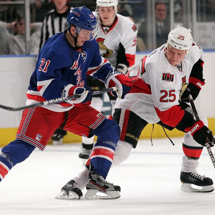 NEW YORK, NY - JANUARY 12: Derek Stepan #21 of the New York Rangers skates alongside Chris Neil #25 of the Ottawa Senators at Madison Square Garden on January 12, 2012 in New York City. (Photo by Nick Laham/Getty Images)