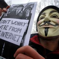 A protester wearing an Anonymous Guy Fawkes mask takes part in a demonstration against controversial Anti-Counterfeiting Trade Agreement (ACTA) as part of an international day of action against the increasingly-contested accord, in Zagreb on February 11, 2012. Tens of thousands of people marched in protests in more than a dozen European cities against a controversial anti-online piracy pact that critics say could curtail Internet freedom. ACTA was signed last year in Tokyo, and aims to bolster international standards for intellectual property protection, for example by doing more to fight counterfeit medicine and other goods. But its attempt to attack illegal downloading and Internet file-sharing has sparked angry protests from users, who fear it could curtail online freedom.  AFP PHOTO / HRVOJE POLAN (Photo credit should read HRVOJE POLAN/AFP/Getty Images)