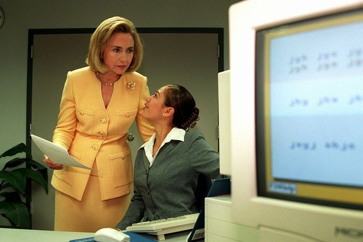 First Lady Hillary Rodham Clinton speaks to learning center student Angelica Chavez Wednesday, Sept. 11, 1996 in the Boyle Heights section in Los Angeles. Chavez was explaining a new computer program to the first lady during her Los Angeles visit. In a speech at the center later in the day, Mrs. Clinton said it will take an electronic village to provide eduction in the next century. (AP Photo/Rene Macura)