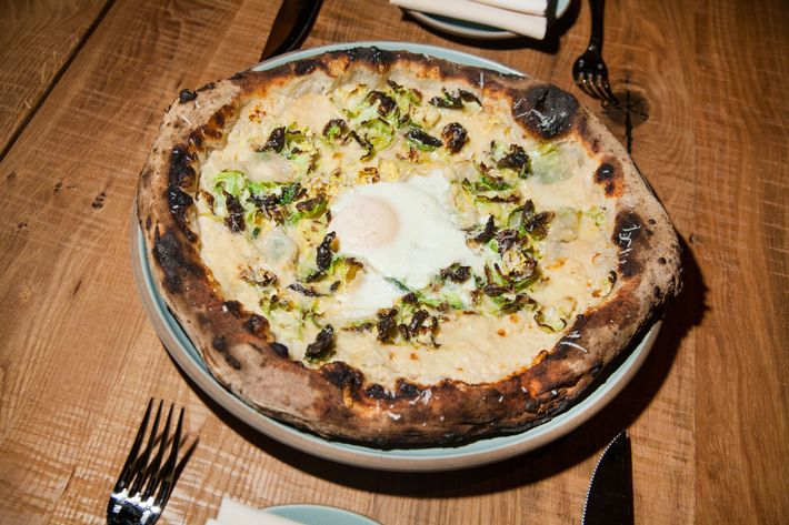 The fontina-and-Brussels-sprout pizza with optional egg is cooked in a wood-burning Stefano Ferrara oven.