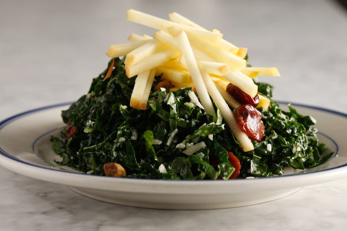 Kale salad with Honeycrisp apples, dried cherries, toasted pistachios, and Parmesan.