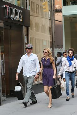 "Jon Hamm of ""Mad Men"" and longtime partner Jennifer Westfeldt look madly in love as they stroll hand in hand on Madison Avenue after shopping at Barneys on Madison. They were spotted on the Eighth floor shopping for women's clothing."