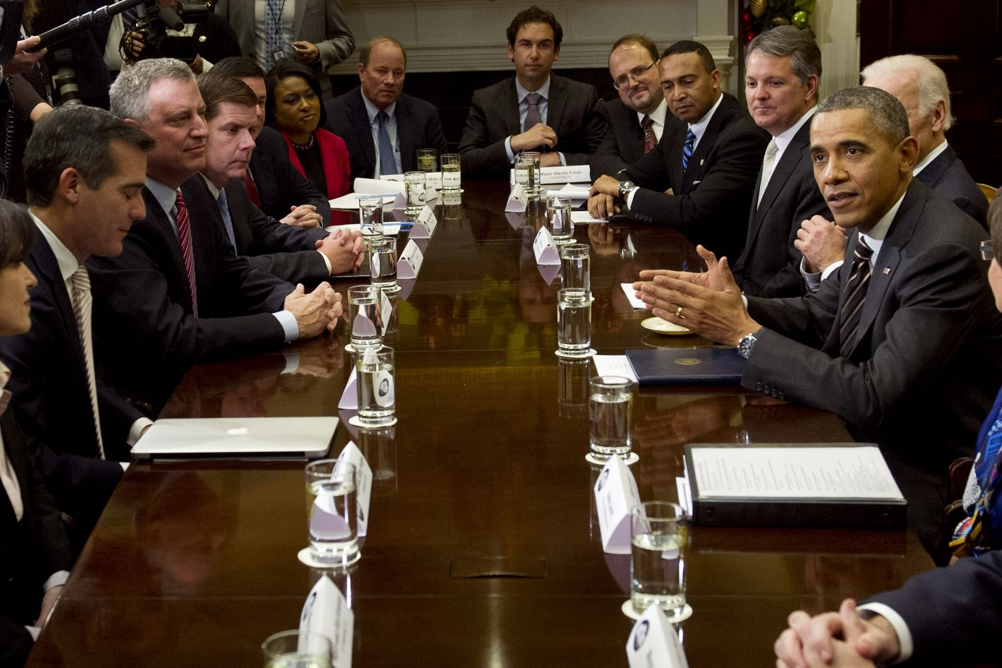 US President Barack Obama speaks during a meeting with a group of newly-elected mayors from across the US in the Roosevelt Room at the White House in Washington, DC, December 13, 2013.