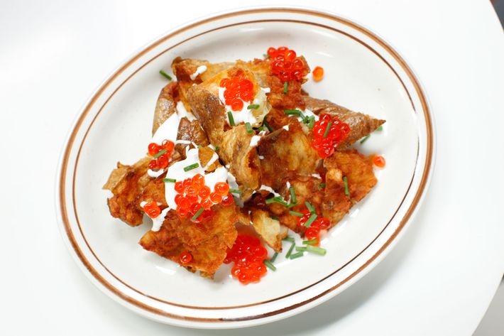 The potato skins come with salmon roe, crème fraîche, and chives.