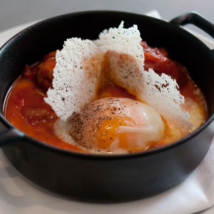 Fennel-sage chicken meatballs and araucana poached egg with creamy grits and tomato fondue.