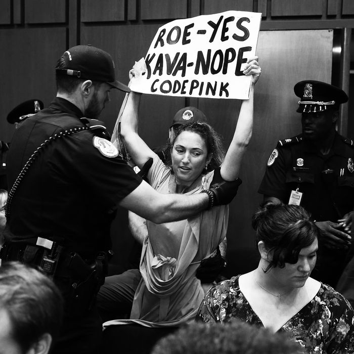 Protester escorted out during the Kavanaugh hearing.