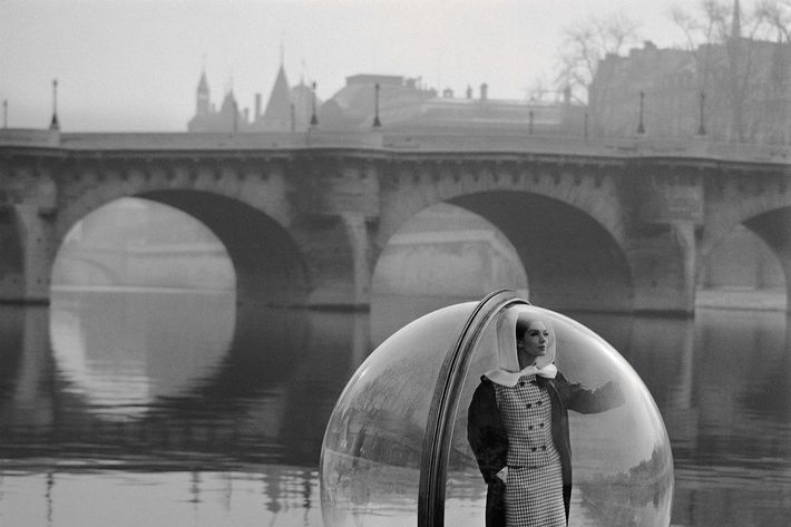 Melivn Sokolsky's On The Siene, featuring model Simone D'Aillencourt, from his fashion editorial shoot Bubble, appearing in the March 1963 issue of Harper's Bazaar.