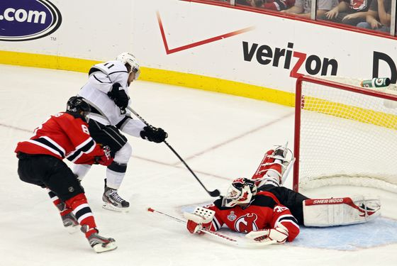 NEWARK, NJ - MAY 30:  Anze Kopitar #11 of the Los Angeles Kings shoots the game winning goal in overtime against Dainius Zubrus #8 and Martin Brodeur #30 of the New Jersey Devils during Game One of the 2012 NHL Stanley Cup Final at the Prudential Center on May 30, 2012 in Newark, New Jersey.  (Photo by Jim McIsaac/Getty Images)