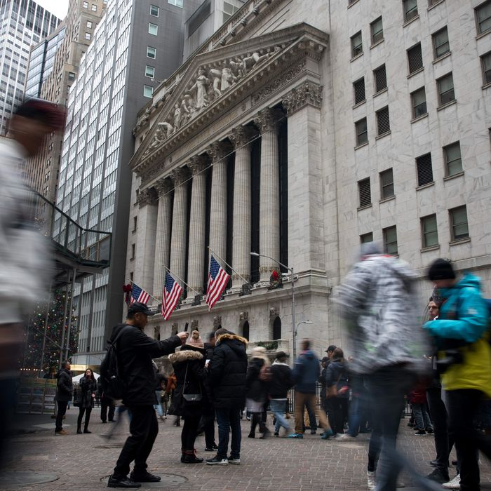 Pedestrians pass in front of the New York Stock Exchange (NYSE) in New York, U.S., on Tuesday, Dec. 31, 2019. U.S. stocks fell in thin end-of-year trading, as rising tensions in the Middle East drove some profit taking after one of the strongest years for equities in the past decade.Photographer: Michael Nagle/Bloomberg via Getty Images