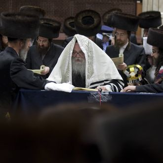 Ultra-Orthodox Jews read the Esther scrolls at a synagogue in the Israeli town of Bnei Brak near Tel Aviv on March 7, 2012 during celebrations of the Purim holiday. The carnival-like Purim holiday is celebrated from the evening of March 7 with parades and costume parties to commemorate the deliverance of the Jewish people from a plot to exterminate them in the ancient Persian empire 2,500 years ago, as recorded in the Biblical Book of Esther.