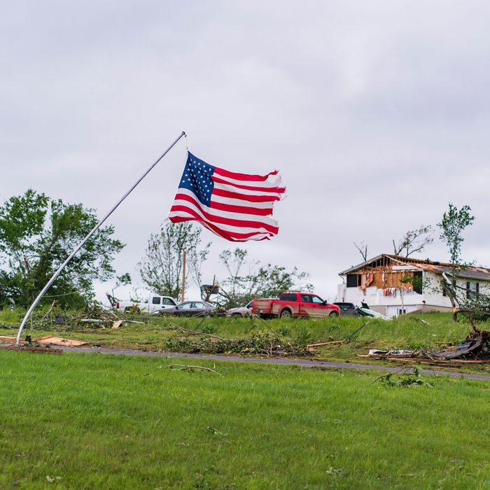Clouds loom over the aftermath of a tornado.