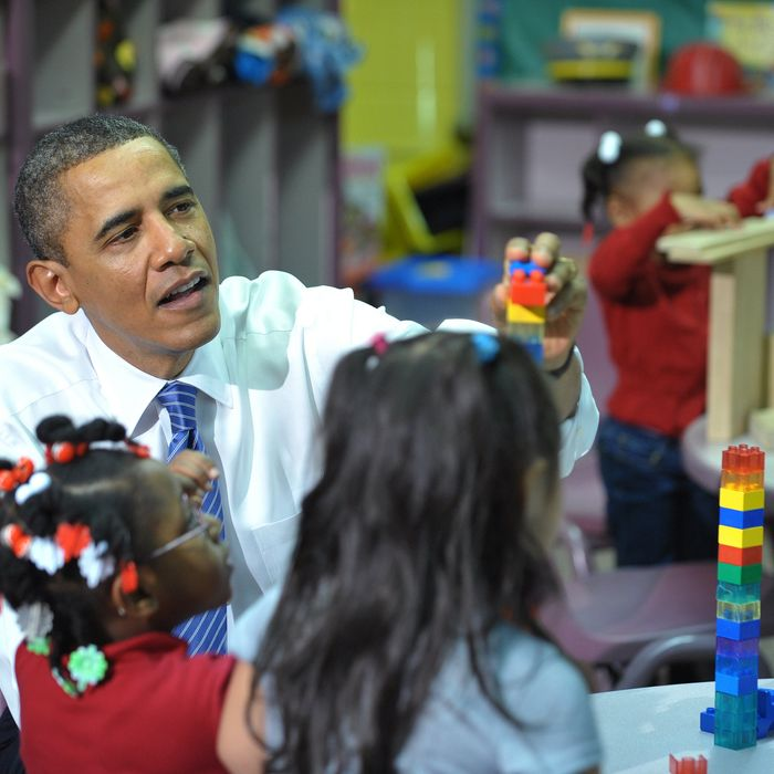 US President Barack Obama helps children place a block while touring a classroom in the Yeadon Regional Head Start Center November 8, 2011 in Yeadon, Pennsylvania. AFP PHOTO/Mandel NGAN (Photo credit should read MANDEL NGAN/AFP/Getty Images)