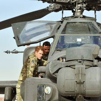 CAMP BASTION, AFGHANISTAN - SEPTEMBER 07: Prince Harry examines the 30mm cannon of an Apache helicopter with a member of his squadron (name not provided) on September 7, 2012 at Camp Bastion, Afghanistan. Prince Harry has been redeployed to the region to pilot attack helicopters. (Photo by John Stillwell - Pool/Getty Images)