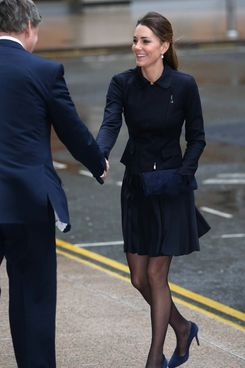 Catherine, Duchess of Cambridge arrives at Clifford Chance to attend the Place2Be Forum at Canary Wharf on November 20, 2013 in London, England.