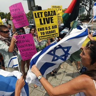 Protestors and counter-protestors shout slogans at each other during a demonstration against Israel's military operations in the Gaza Strip, August 2, 2014 in front of the Federal Building in Los Angeles, California.