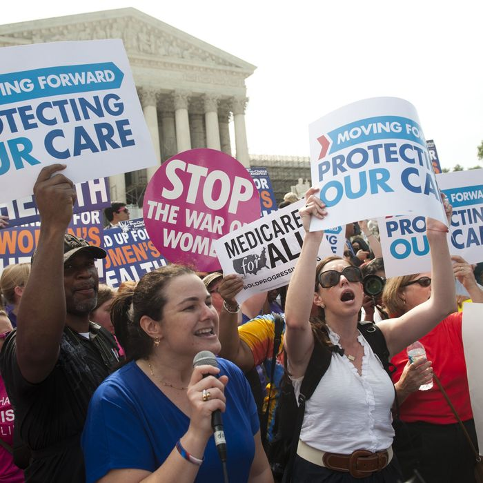 Supporters of US President Barack Obama's signature healthcare legislation celebrate after the US Supreme Court upheld the constitutionality of the Affordable Healthcare Act, outside the Supreme Court in Washington, DC, June 28, 2012.