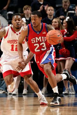 MEMPHIS, TN - MARCH 11: Paul McCoy #23 of the SMU Mustangs brings the ball upcourt past Aubrey Coleman #12 of the Houston Cougars during Round One of the Conference USA Basketball Tournament at FedExForum on March 11, 2009 in Memphis, Tennessee. Tulane beat East Carolina 69-59. (Photo by Joe Murphy/Getty Images)