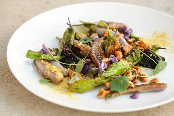 Fairy-tale eggplant with black cashew, shishito peppers, opal basil, and nutritional yeast.