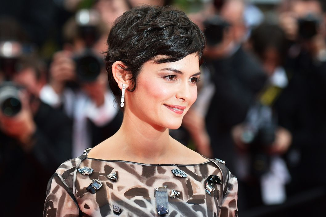 French actress Audrey Tautou poses as she arrives for the Opening ceremony of the 67th edition of the Cannes Film Festival in Cannes, southern France, on May 14, 2014. AFP PHOTO / ALBERTO PIZZOLI        (Photo credit should read ALBERTO PIZZOLI/AFP/Getty Images)