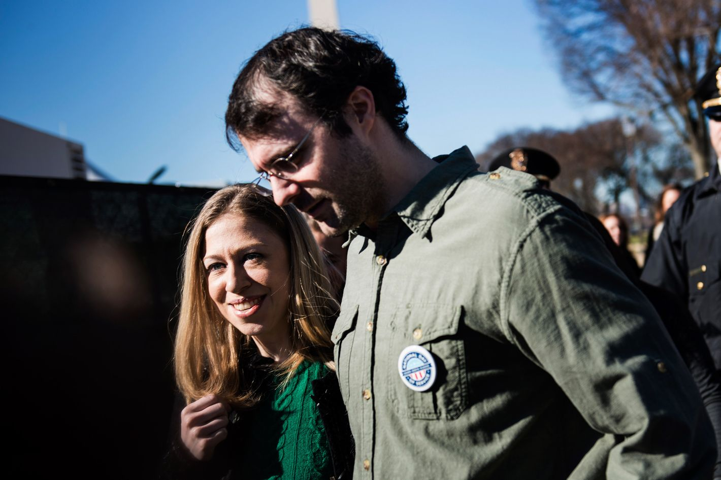 Chelsea Clinton and her husband Marc Mezvinsky walk on the National Mall January 19, 2013 in Washington, DC.