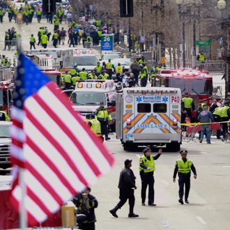 Emergency workers aid injured people at the finish line of the 2013 Boston Marathon following an explosion in Boston, Monday, April 15, 2013.