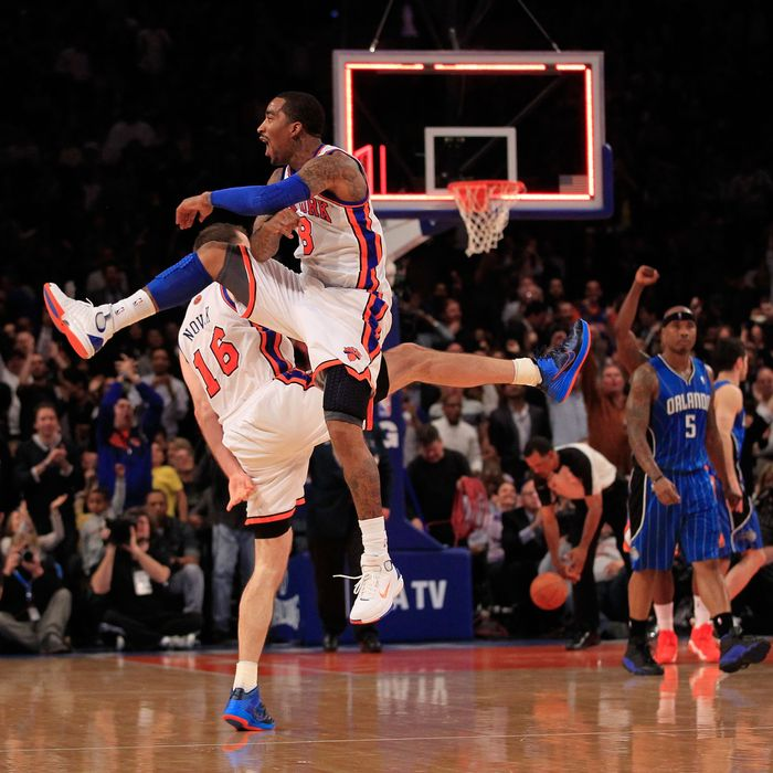 (L) Steve Novak #16 of the New York Knicks and (R) J.R. Smith #8 of the New York Knicks chest bump after Novak hits a three pointer at the end of the first quarter against the Orlando Magic at Madison Square Garden on March 28, 2012 in New York City.