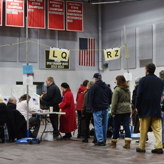 Citizens line up to vote at Belmont High School February 9, 2016 in Belmont, New Hampshire. Voting began in New Hampshire on February 9 in the first US presidential primary, where Donald Trump leads the packed Republican field and Bernie Sanders was polling ahead of Hillary Clinton.
