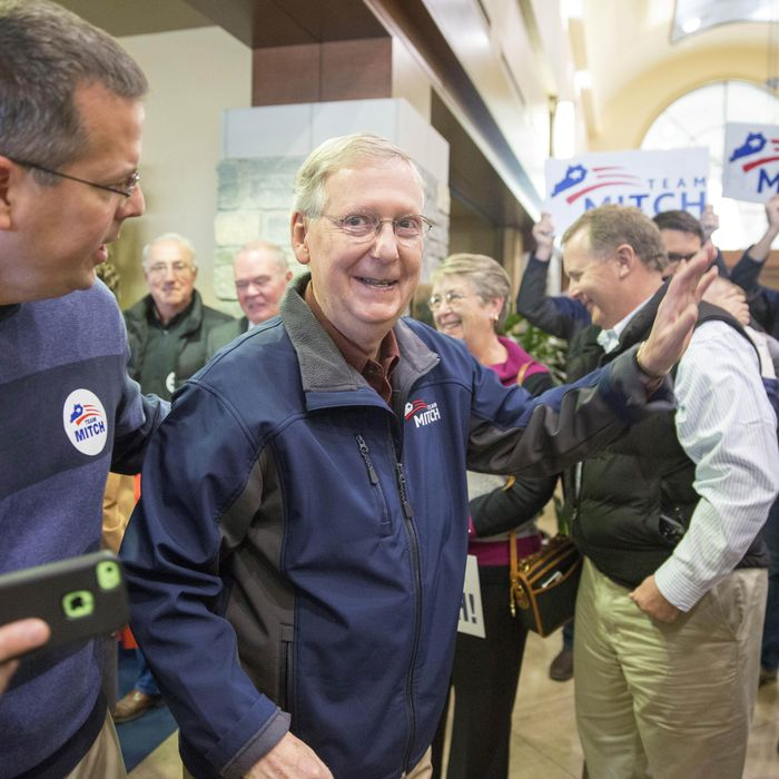 U.S. Sen. Mitch McConnell (R-KY) (L) greets supporters following an election rally at Bluegrass Airport November 3, 2014 in Lexington, Kentucky.