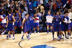 Tyshawn Taylor #10 of the Kansas Jayhawks celebrates with his teammates after they won 80-67 against the North Carolina Tar Heels during the 2012 NCAA Men's Basketball Midwest Regional Final