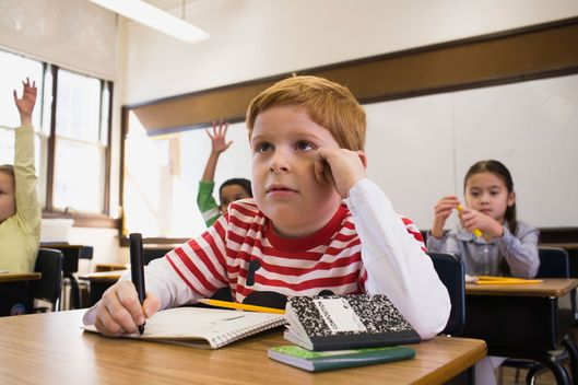 Boy Sitting in Class --- Image by ? Sean De Burca/Corbis