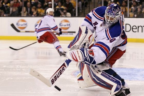 BOSTON, MA - FEBRUARY 14:  Henrik Lundqvist #30 of the New York Rangers clears the puck in the third period against the Boston Bruins on February 14, 2012 at TD Garden in Boston, Massachusetts. The New York Rangers defeated the Boston Bruins 3-0.  (Photo by Elsa/Getty Images)